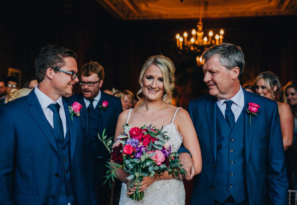bride walks down the aisle - Thornton Manor wedding - cheshire wedding photography