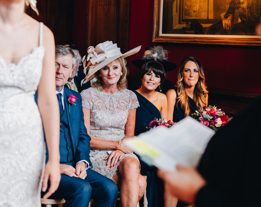 guests look on happily as the couple tie the knot