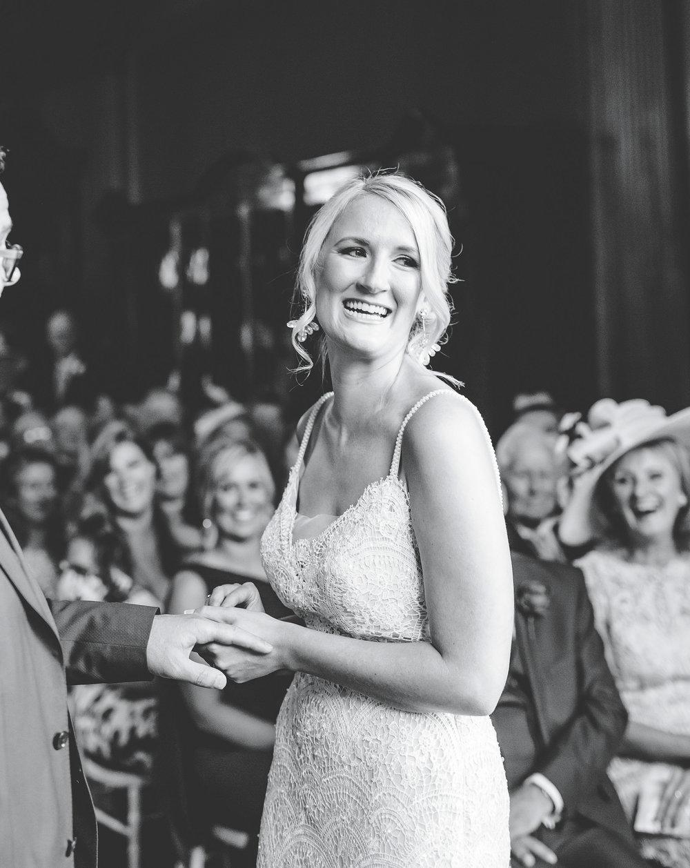bride smiling through the ceremony at Thornton Manor