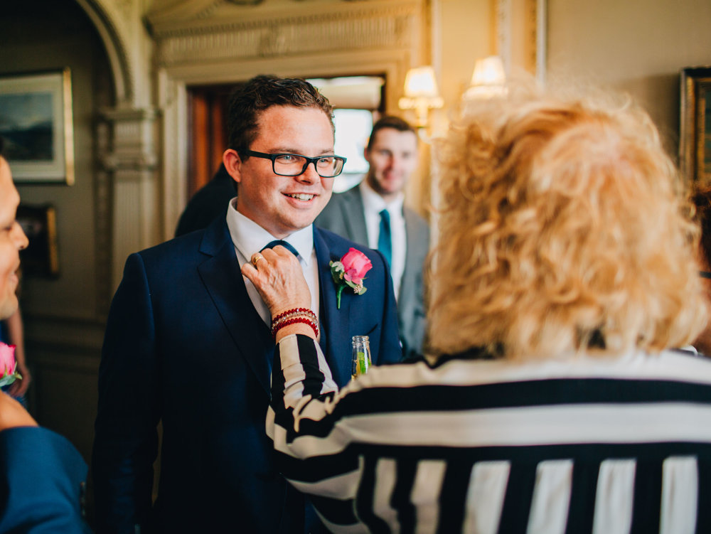 groom greets guests at Thornton Manor