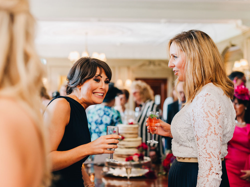 guests smiling and laughing - natural photos in cheshire