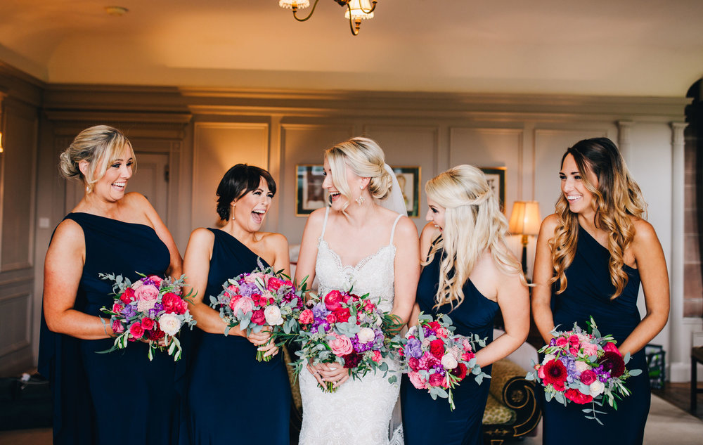 relaxed and natural wedding pictures - bridesmaids laughing