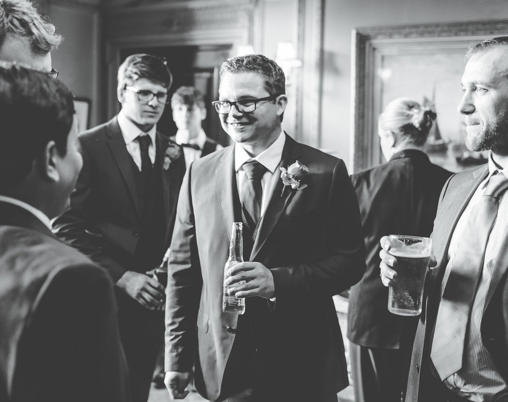 black and white documentary images of the groom greeting guests