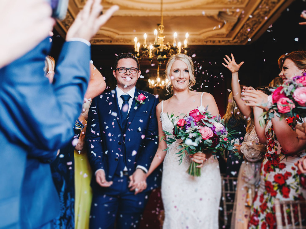 fun and relaxed confetti images - bride and groom at Thornton Manor