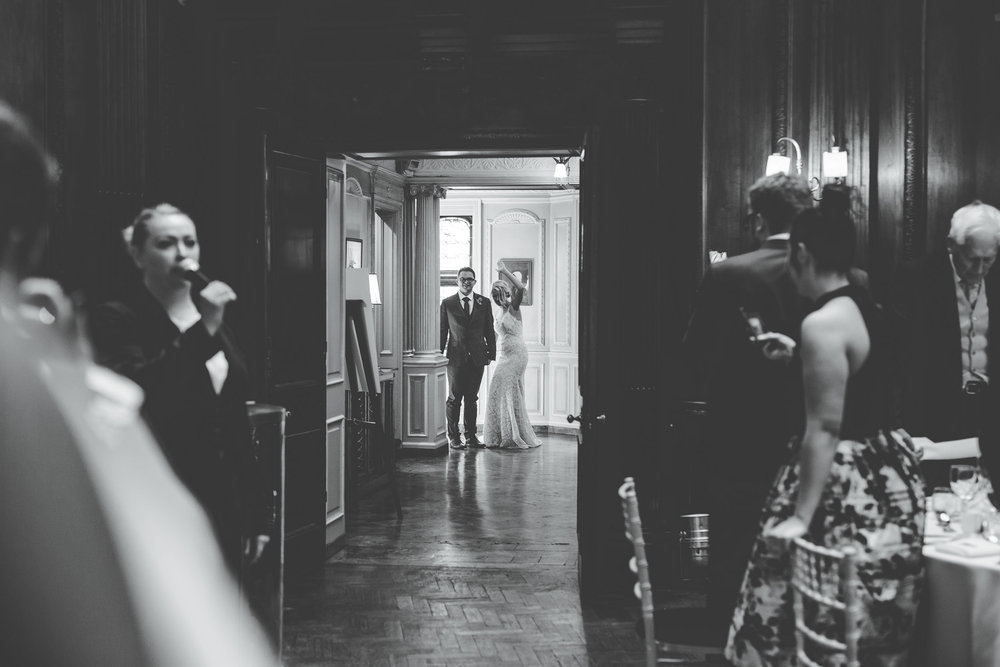 bride and groom arrive at the wedding breakfast