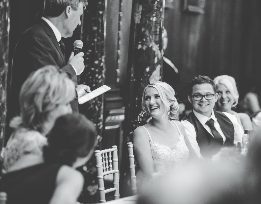 bride laughing during the wedding breakfast speech