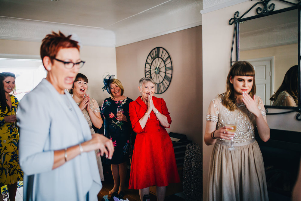 reaction to seeing the bride - liverpool documentary photography