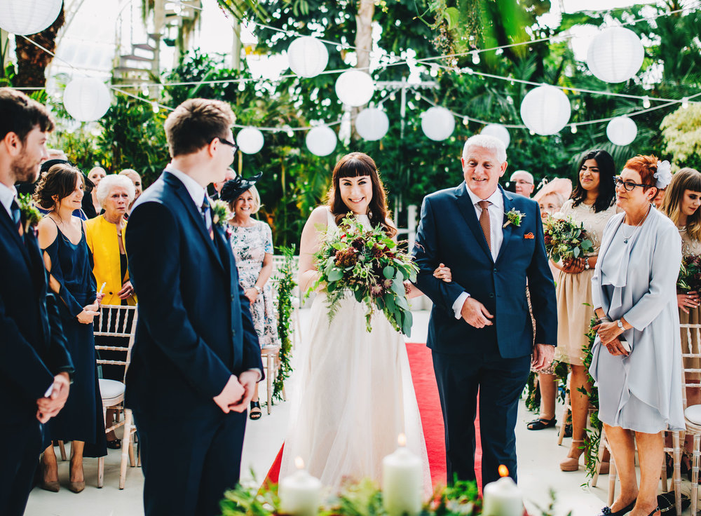 liverpool wedding photographer - bride walks down the aisle at sefton palm house