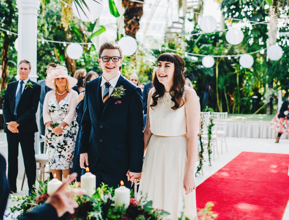 laughter during the wedding ceremony at Sefton Palm House