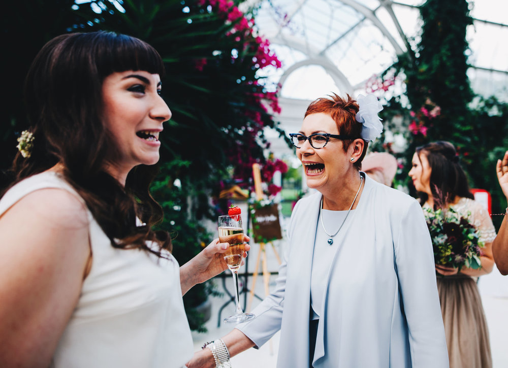 natural pictures of the guests at sefton palm house wedding