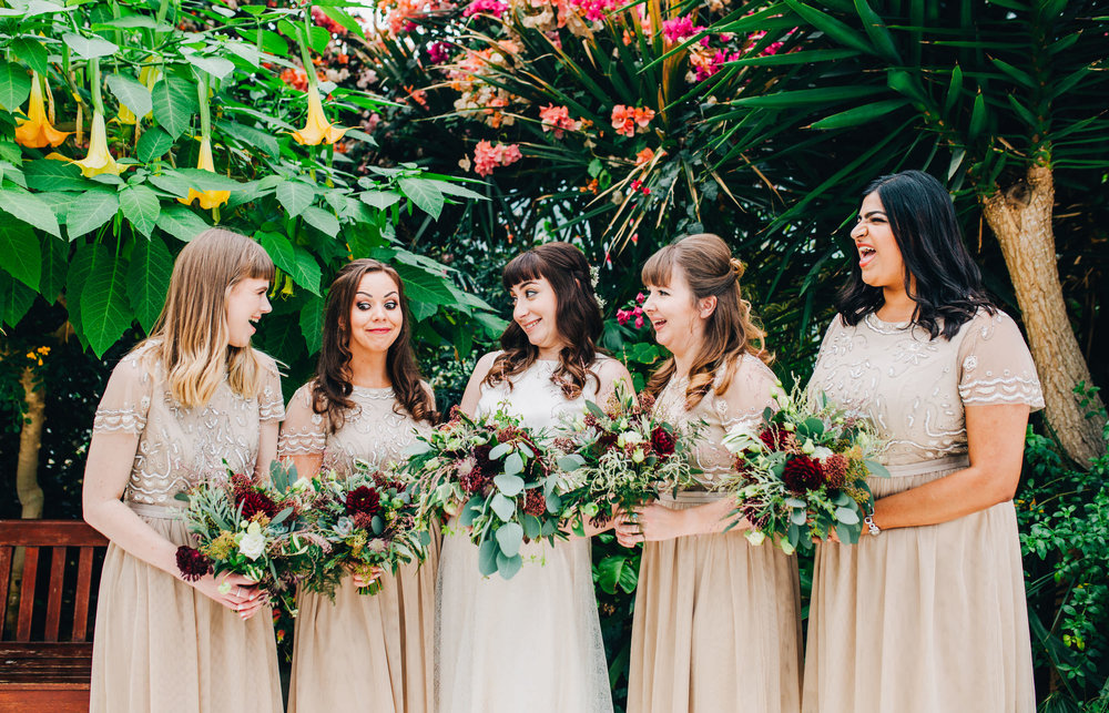 bride and bridesmaid group shot - sefton palm house