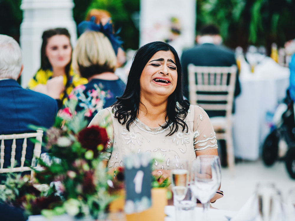 natural shots of guests laughing - liverpool wedding photographer