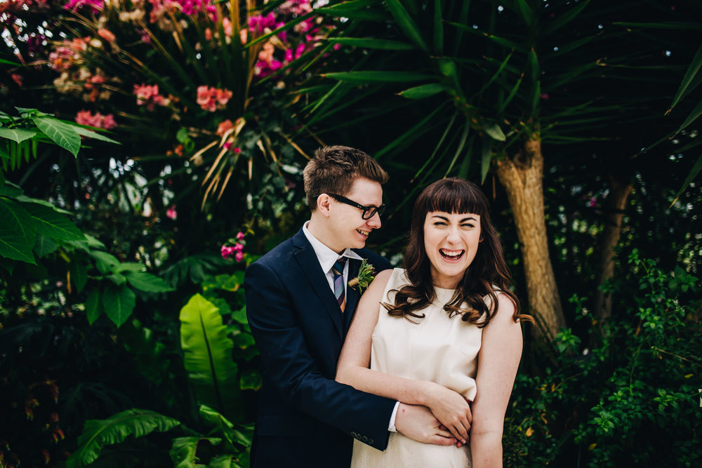 laughing bride and groom - sefton palm house