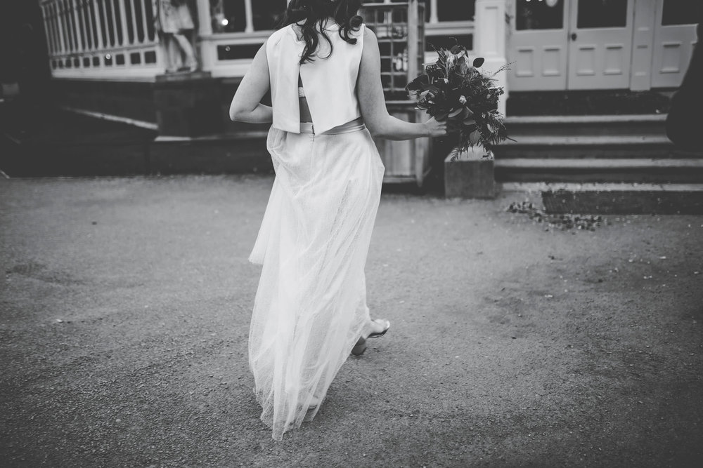 artistic black and white image of the bride's dress
