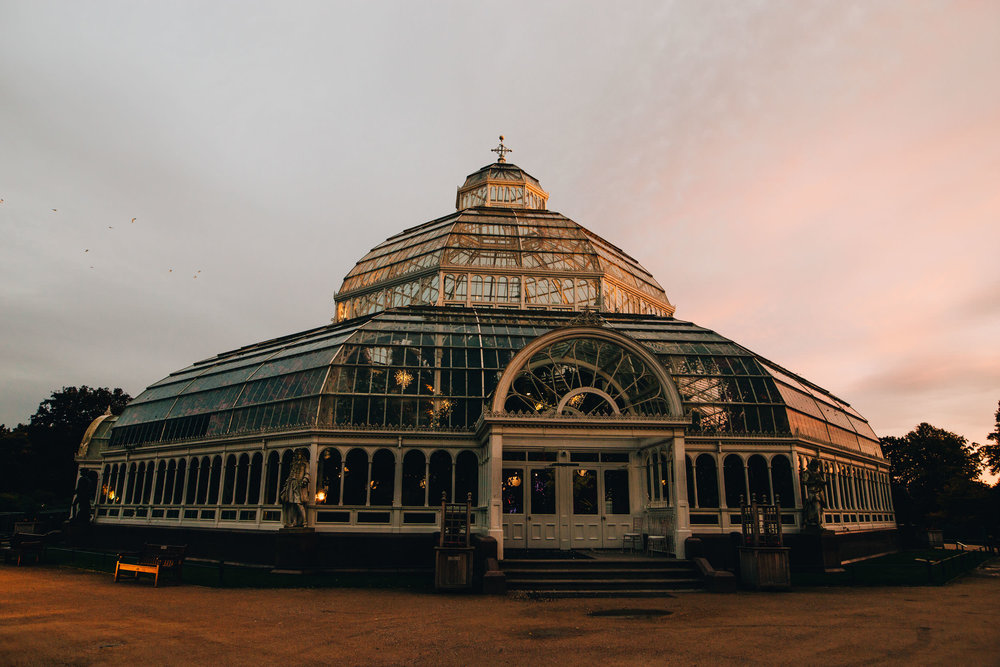exterior of the palm house at sunset