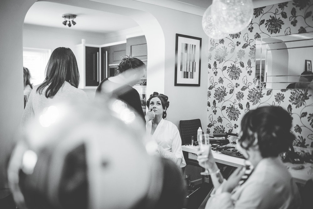 artistic black and white images of the bride getting ready