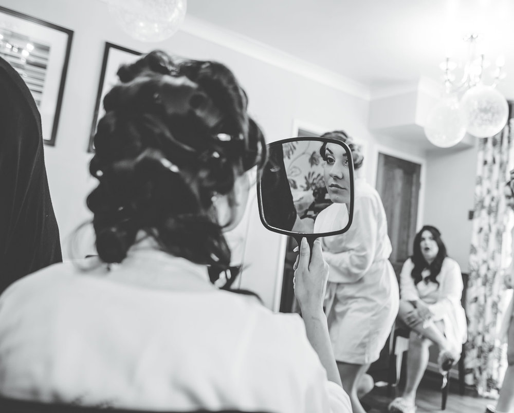 black and white image of bride getting ready - wedding photographer cheshire