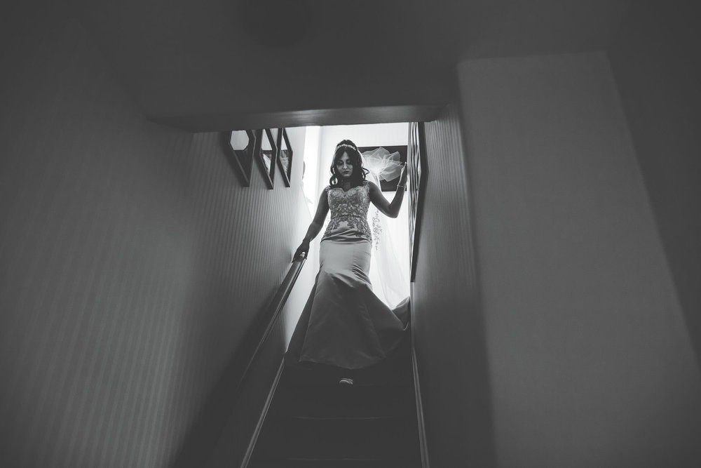 bride walks down the stairs