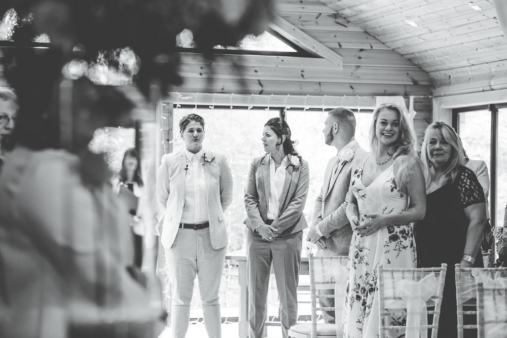 watching bride walk down the aisle - Same sex wedding at Styal lodge