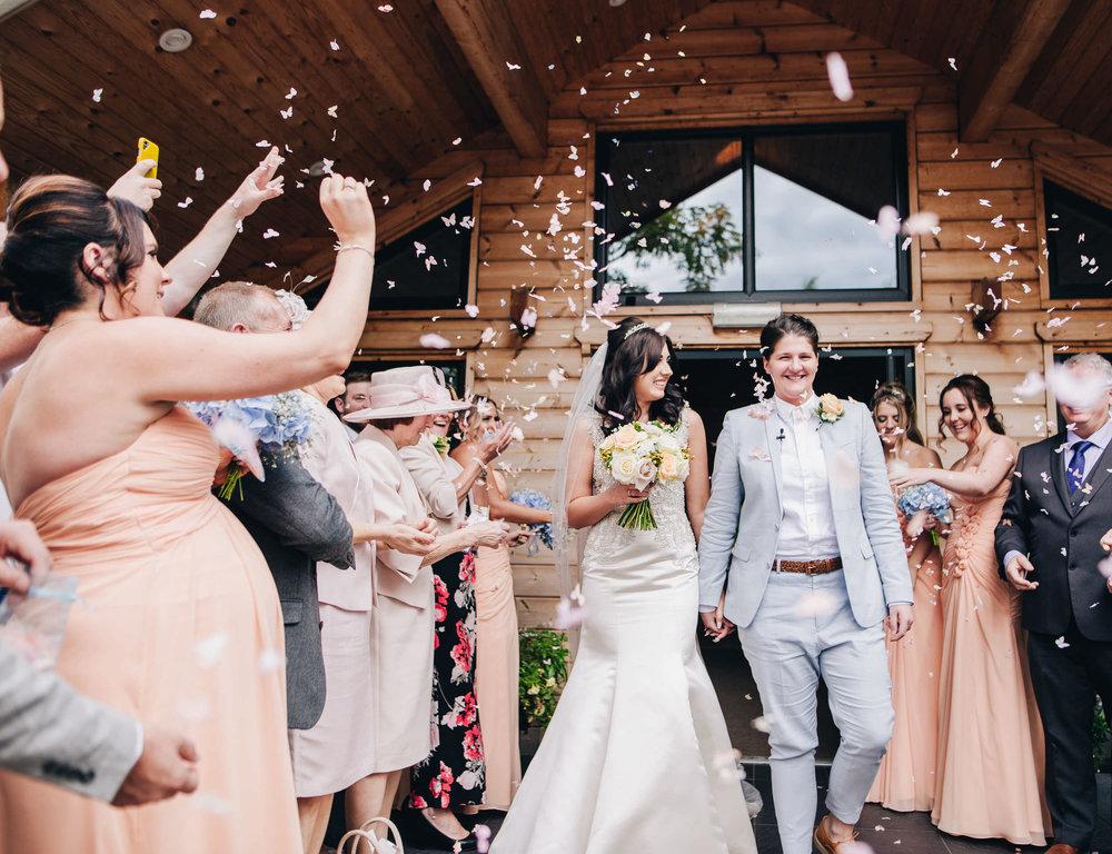 cheshire wedding photographer - confetti outside Styal Lodge