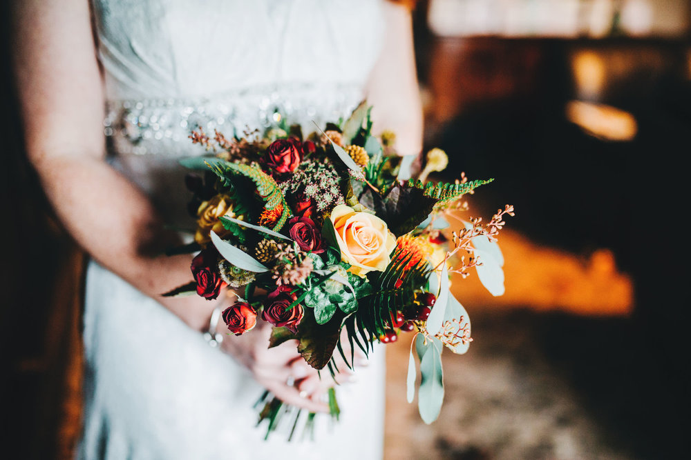 bride holding bouquet - wedding photography lakes