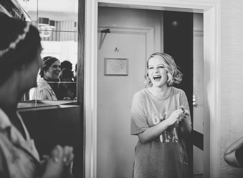 laughing bridesmaid - documentary wedding photography in the lakes