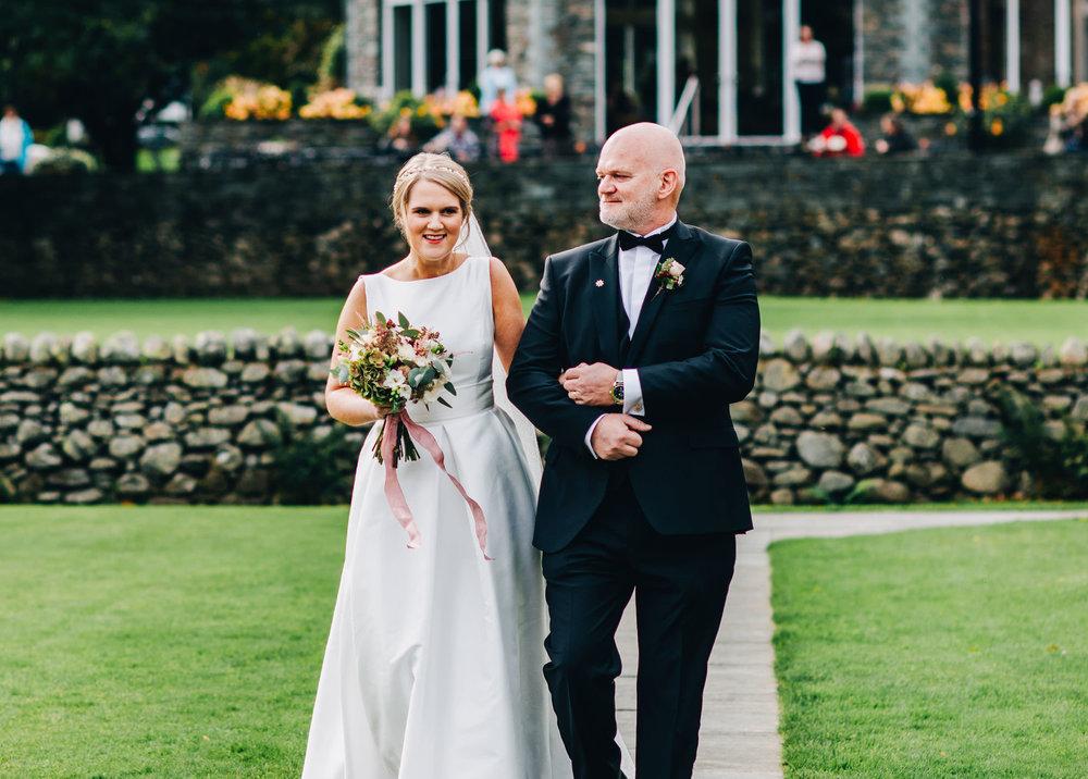 walking to see the groom  - inn on the lake wedding