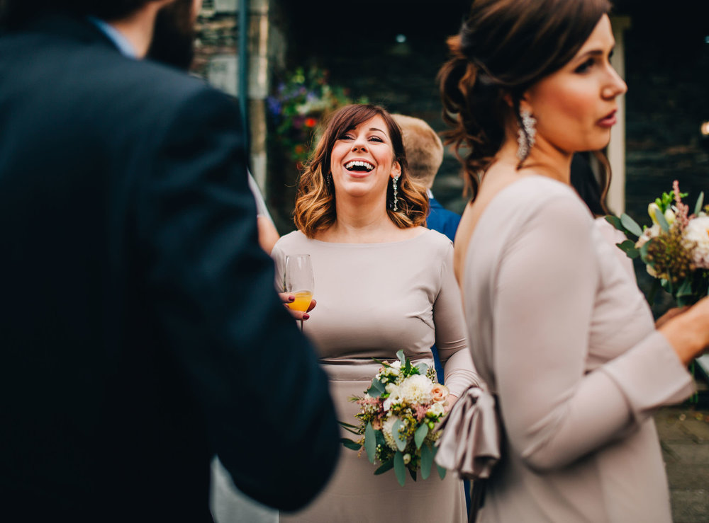 bridesmaid laughing - ceremony at inn on the lake
