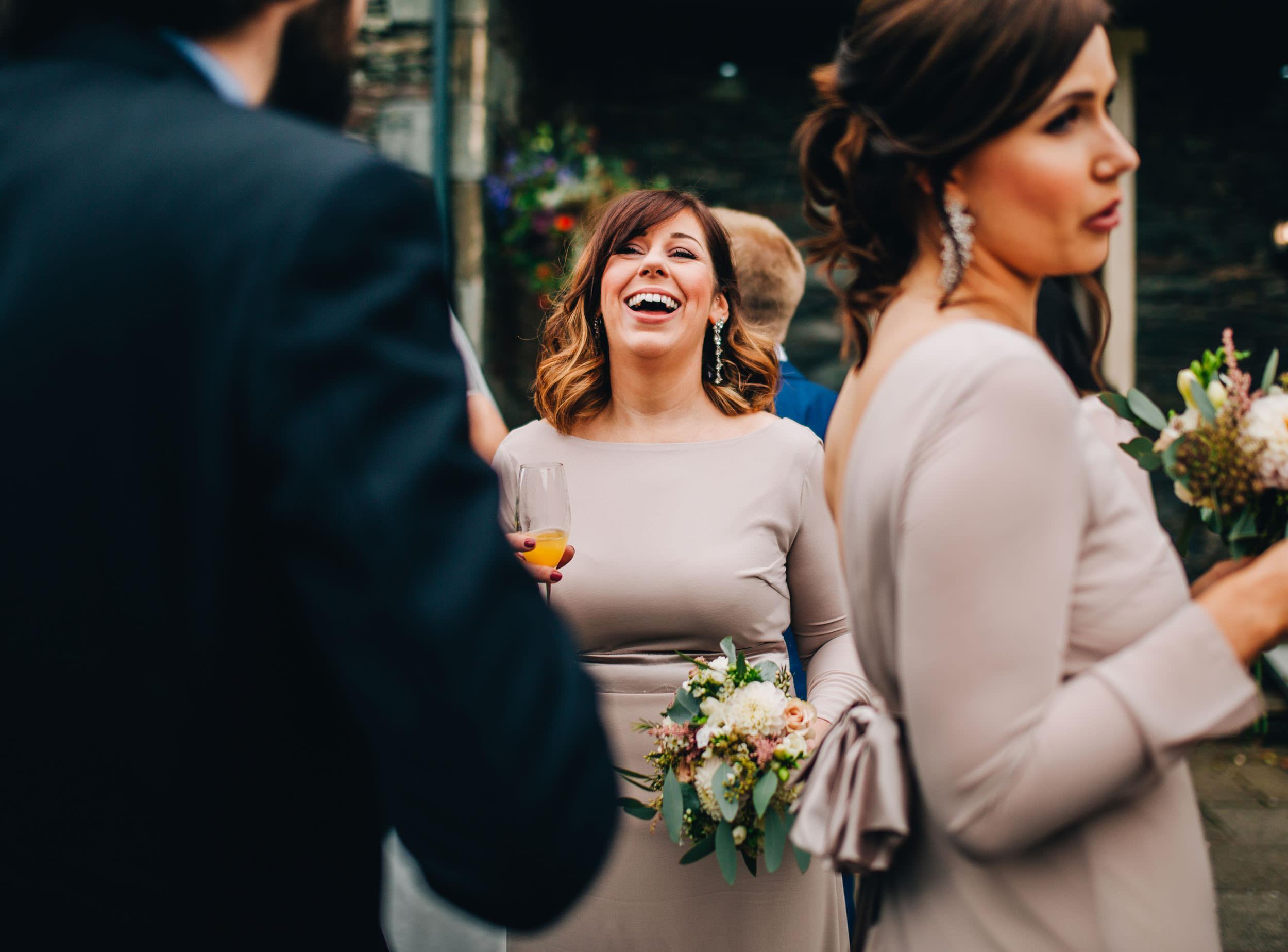 bridesmaid laughing - Lake District wedding photography