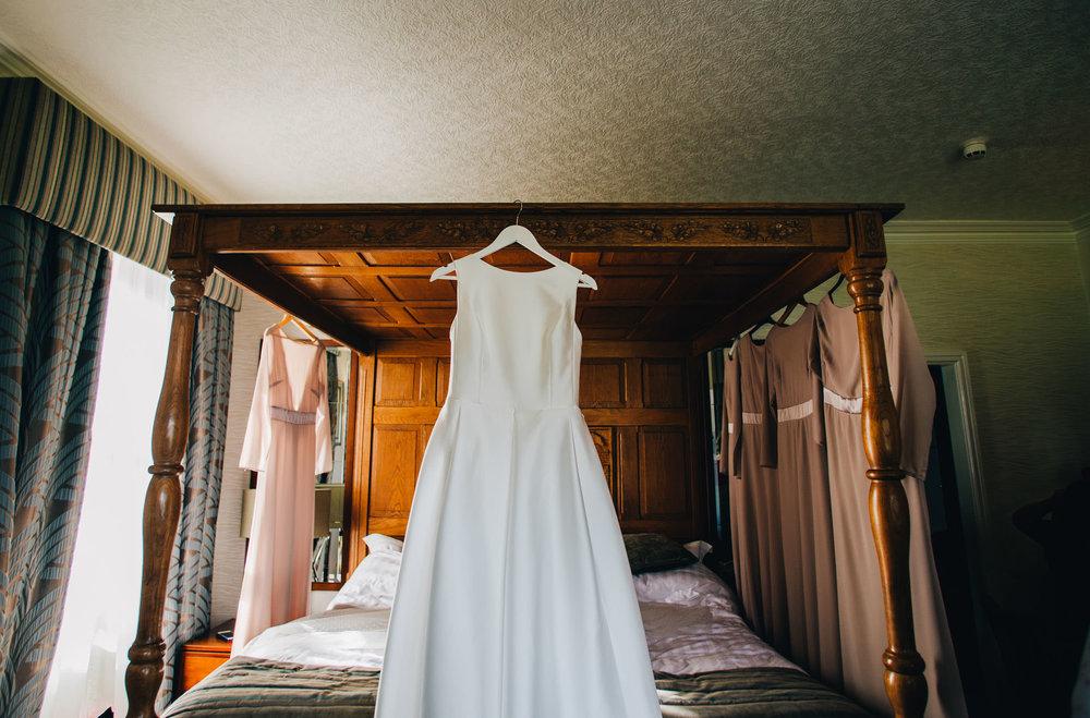 dress hung up at inn on the lake