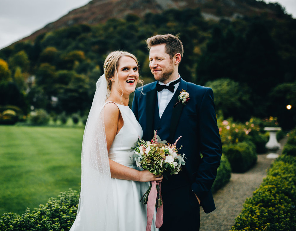 laughing during wedding portraits - bride and groom