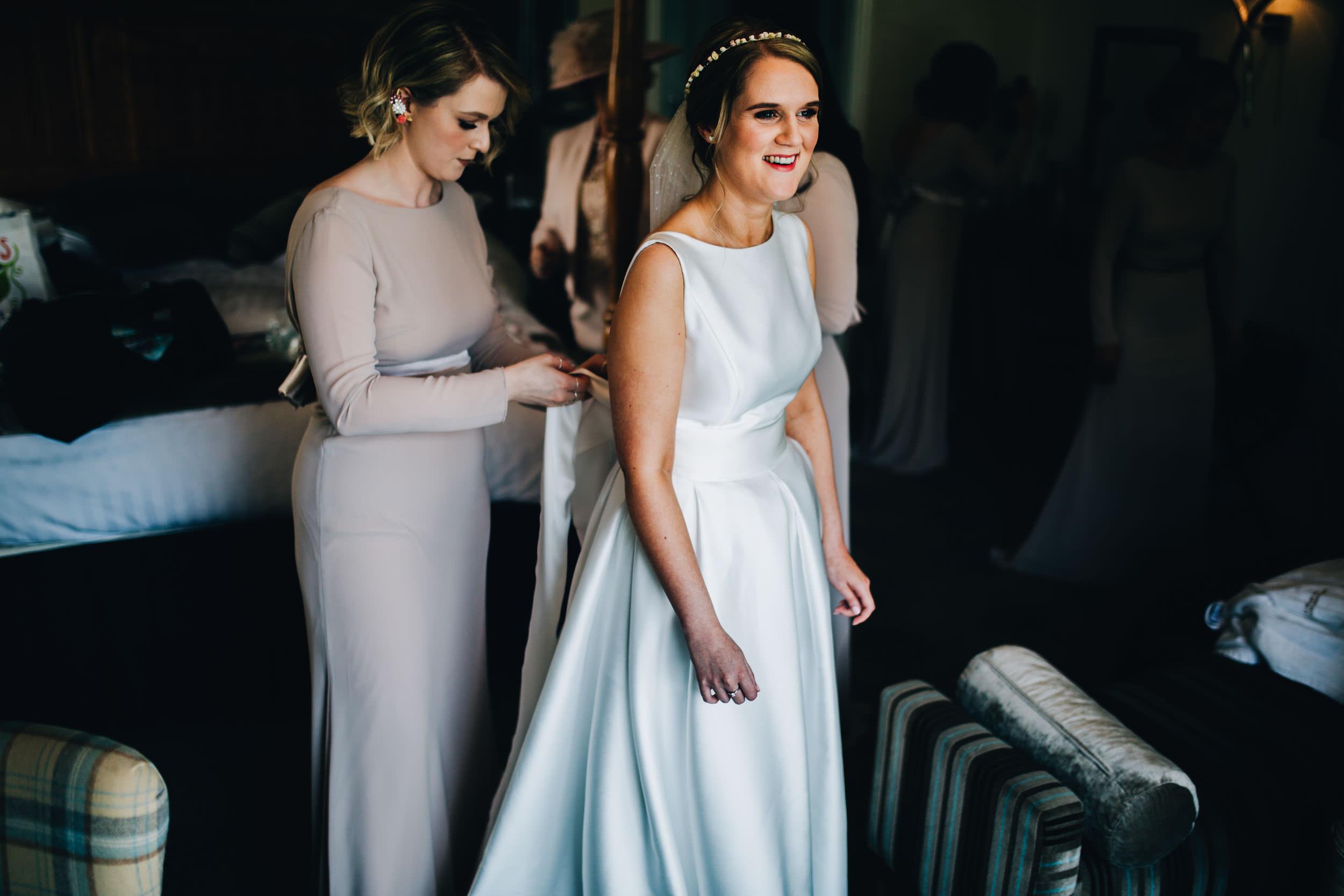 bride getting dressed - Inn on the Lake Wedding Venue