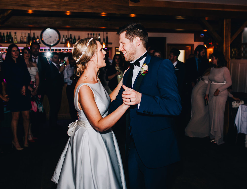 bride and groom's first dance at the inn on the lake