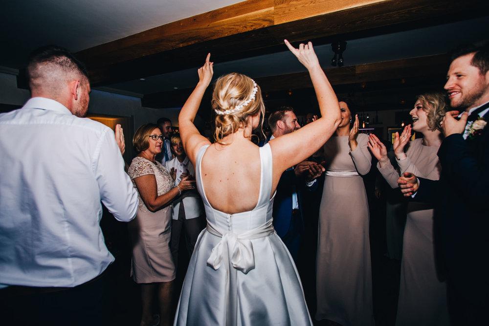 bride getting crazy on the dance floor