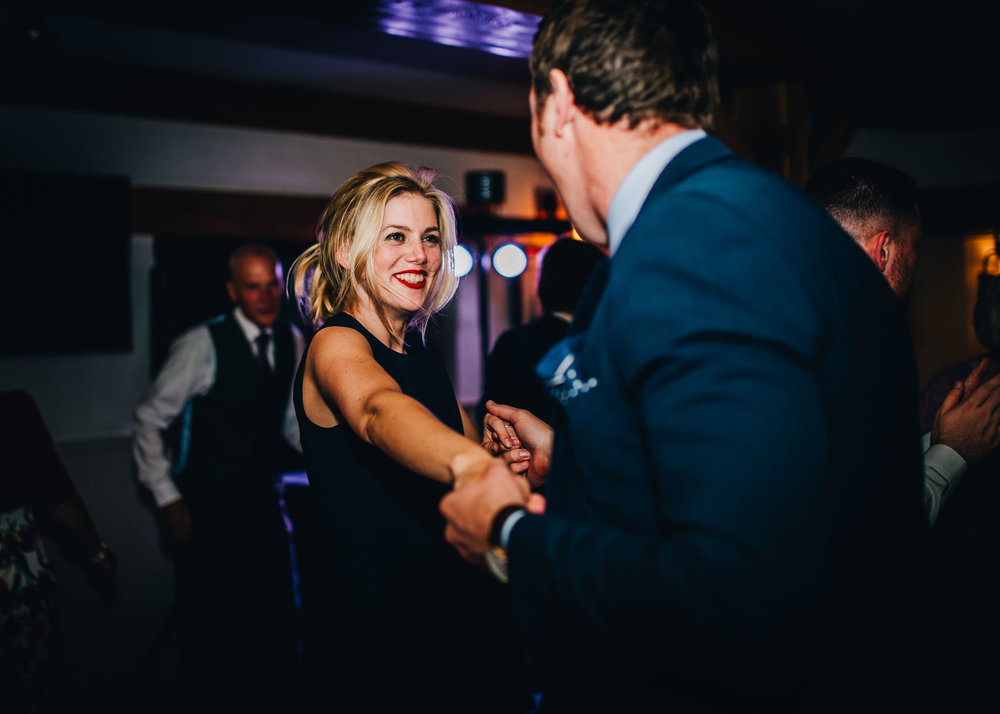 guests laughing and dancing - inn on the lake wedding
