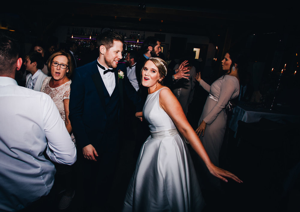 fun bride and groom dancing pictures - wedding photography in the lakes