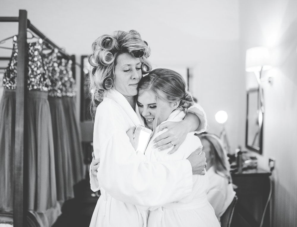 bride and bridesmaid hugging - Lake District wedding photography
