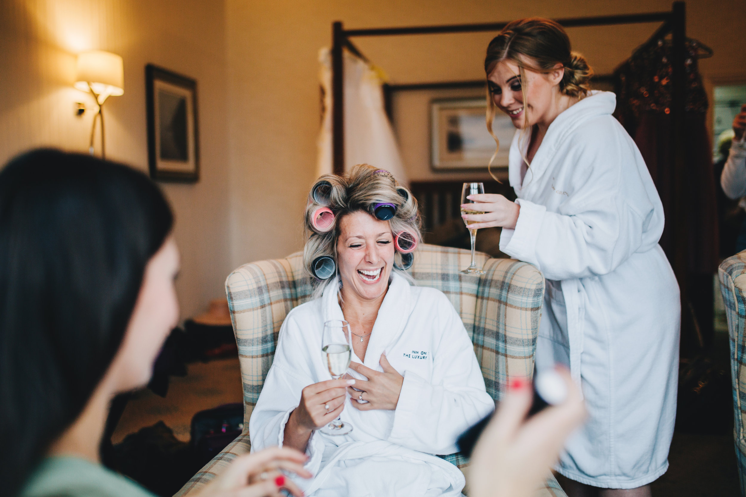 laughter at bride prep  - Lake District wedding photography