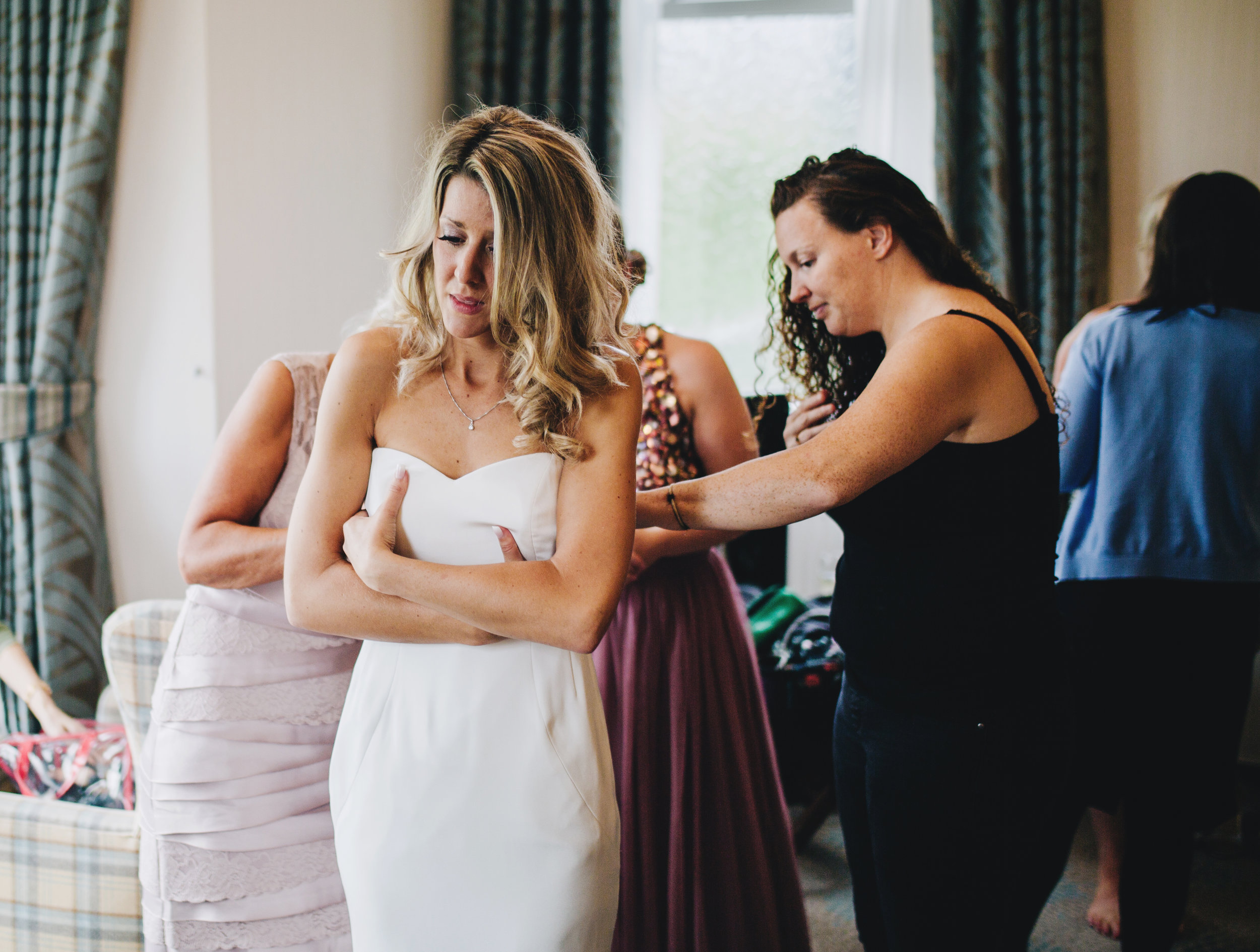 emotional bride gets dressed - Lake district wedding photography