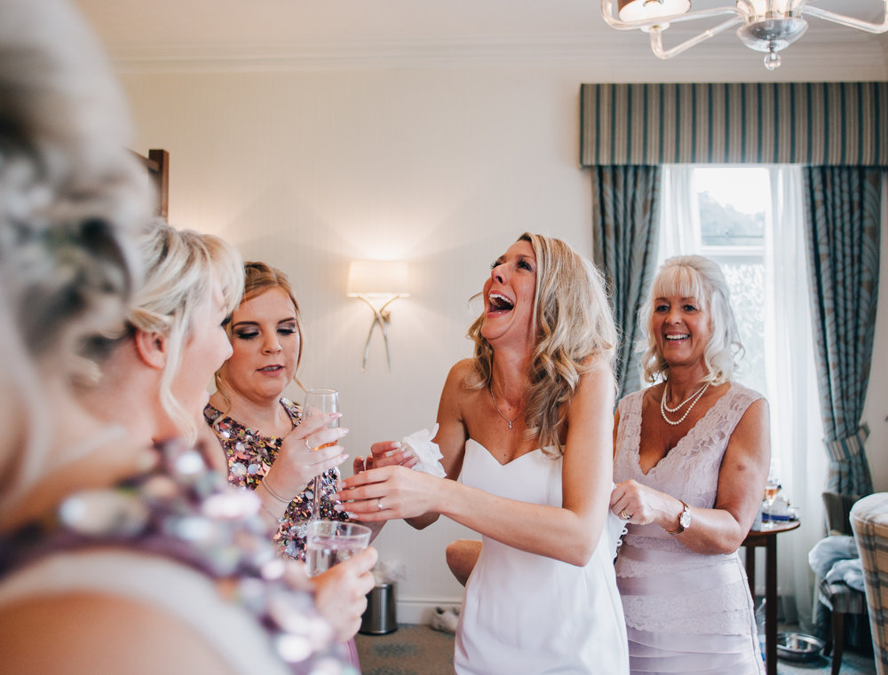 fun and emotional wedding photography - laughing bride