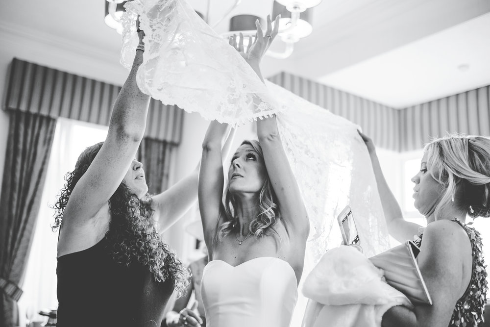 getting into the dress - black and white wedding images