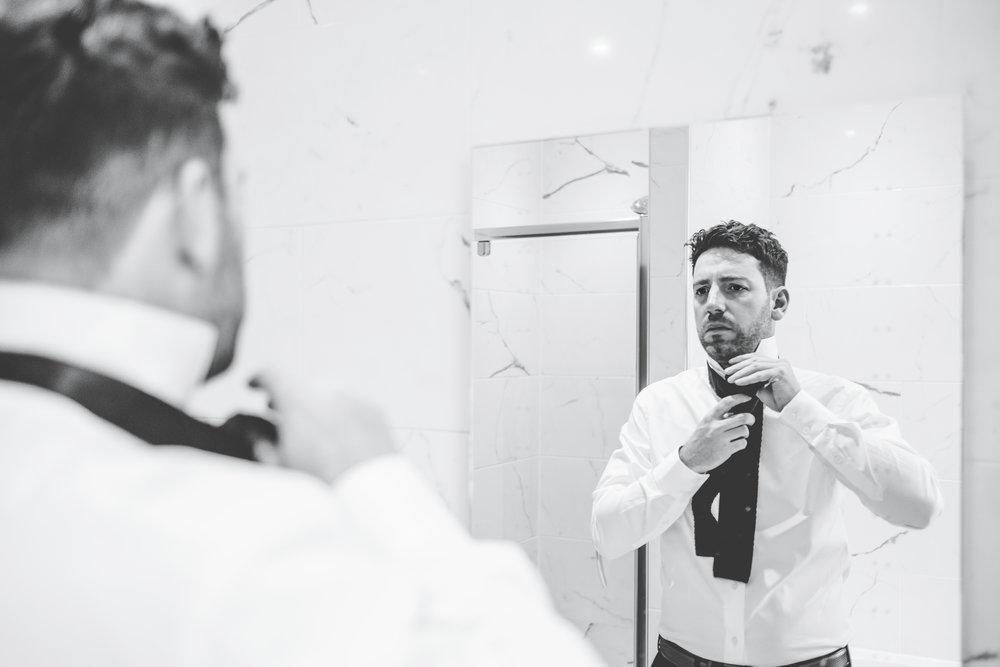 groom getting his tie on
