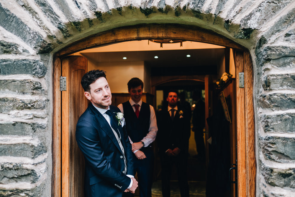 groom waits for the bride to arrive