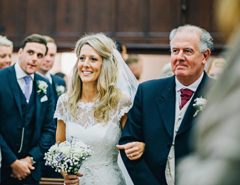 Lake District wedding photography - bride walks down the aisle