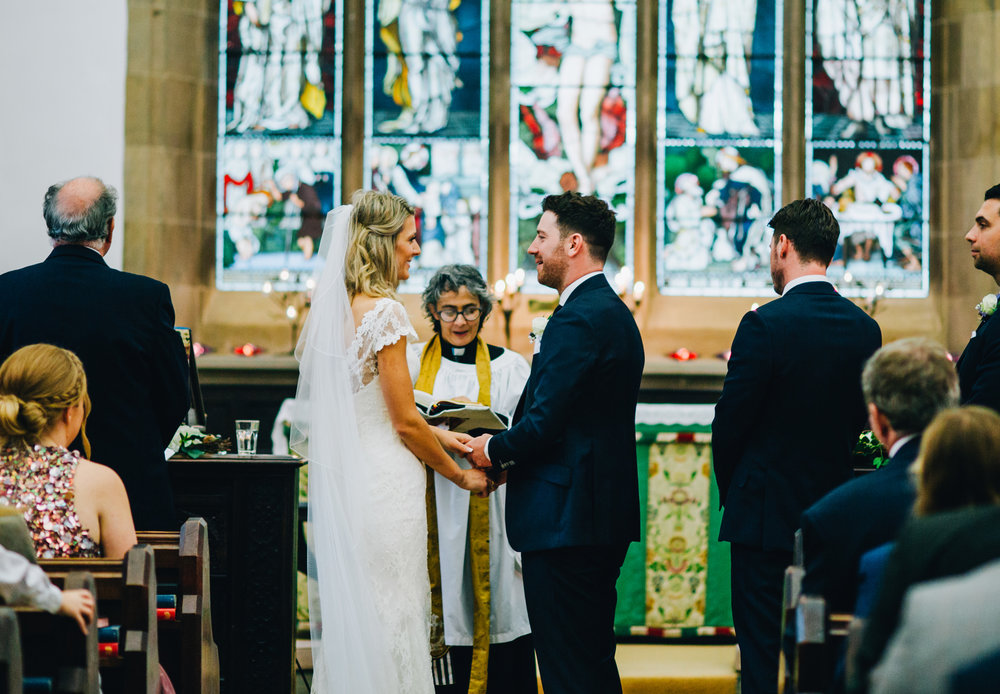 exchanging vows - church wedding in the lakes