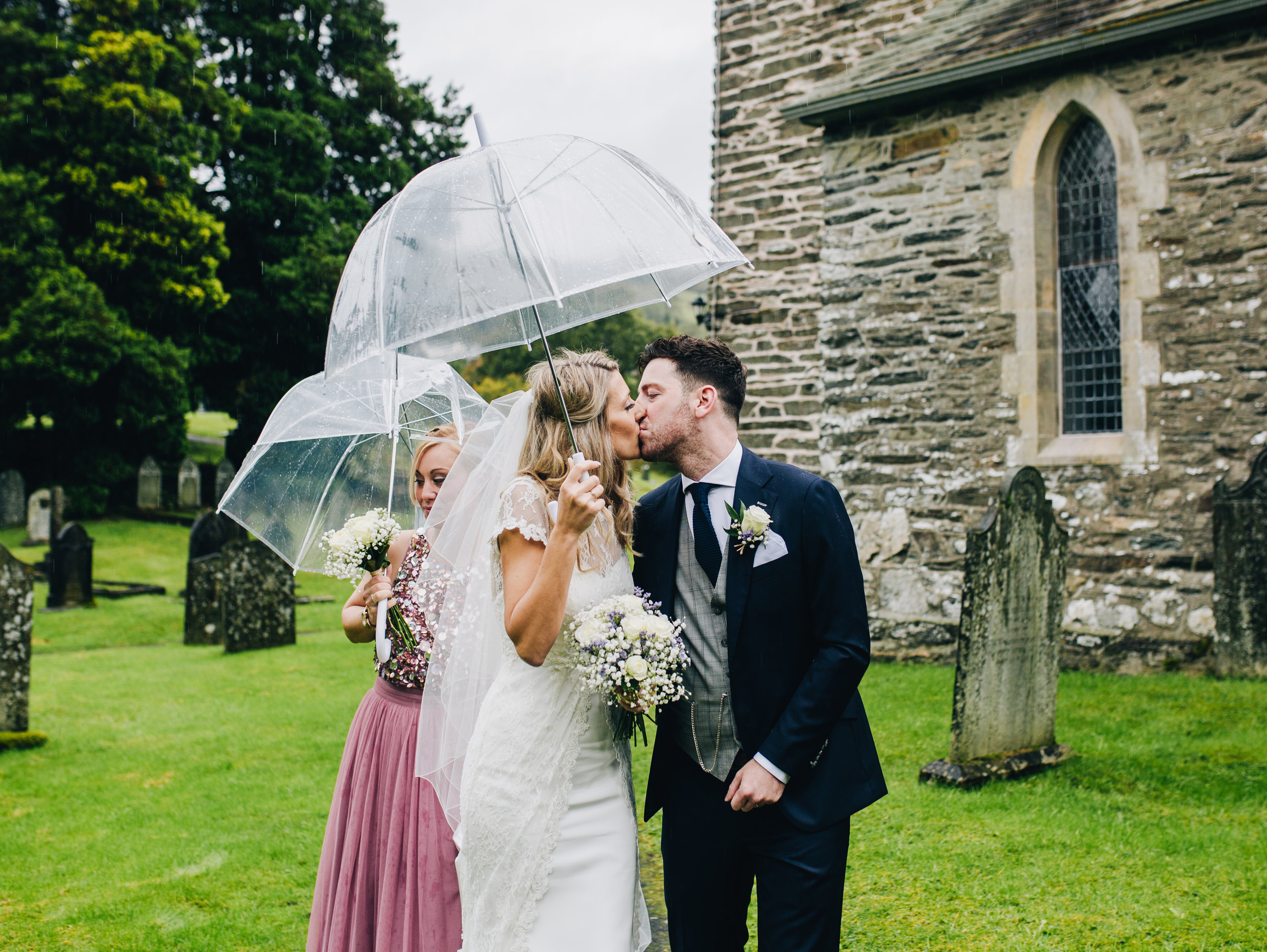 kissing in the rain - Lake District wedding photographer