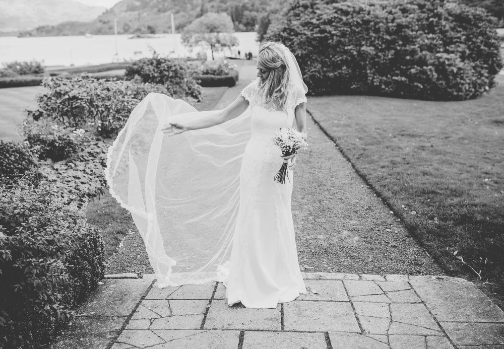 black and white image of the bride at inn on the lake