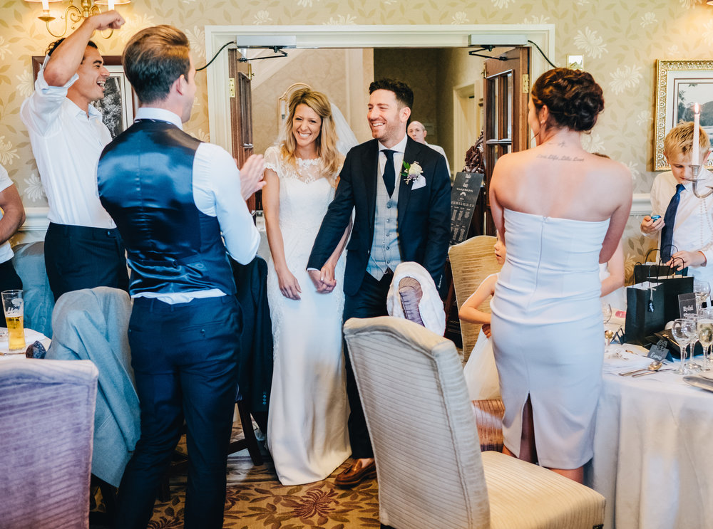 walking into the wedding reception