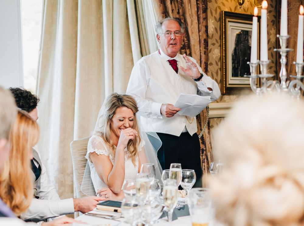 natural wedding pictures - guests laughing