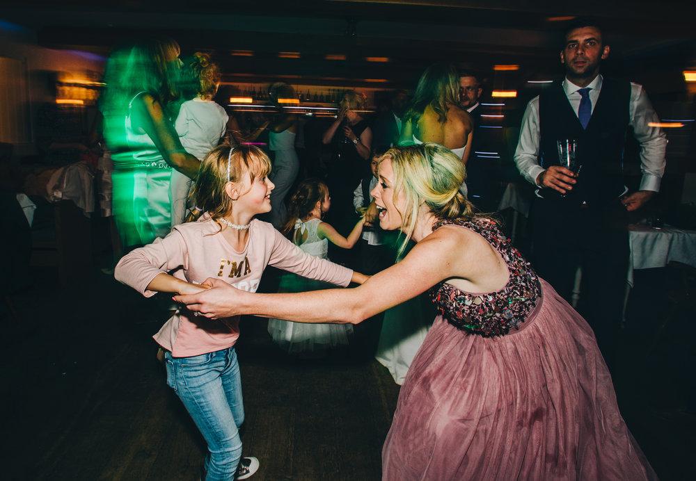 bridesmaids having fun on the dance floor